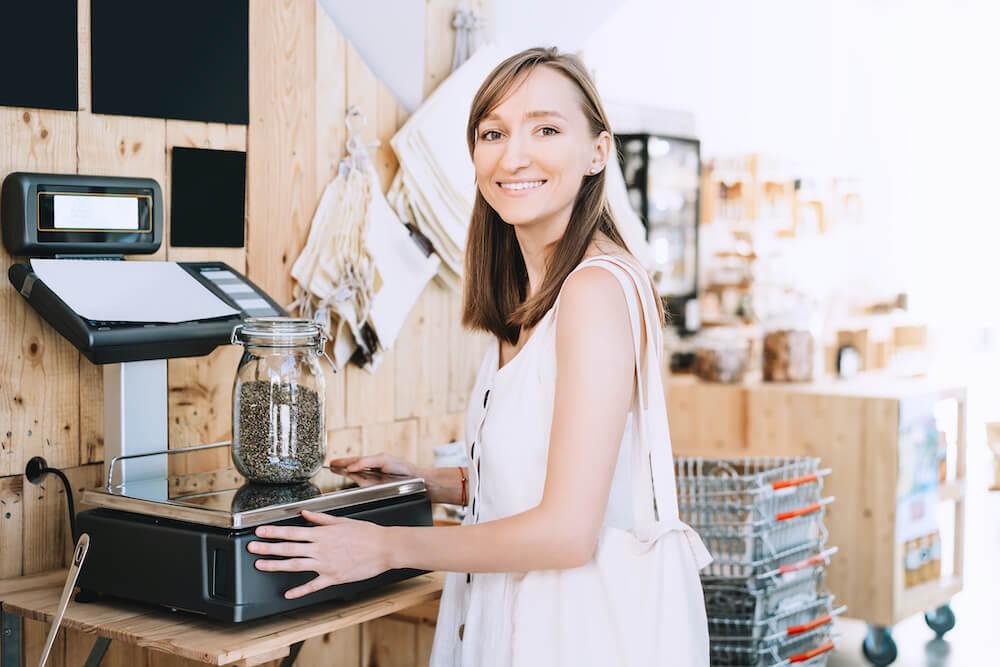 woman weighing marijuana